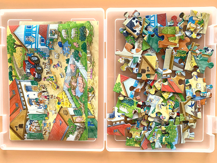 Labels for puzzles in storage at How we Montessori storing ravenburger puzzles