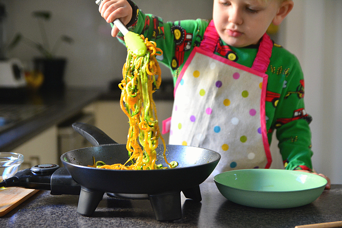 Cooking as a sensory experience at How we Montessori toddler cooking with electric pan