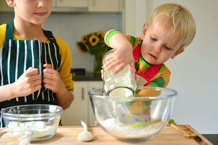 Otto 2.5 year with child made flat bread and curry at How we Montessori