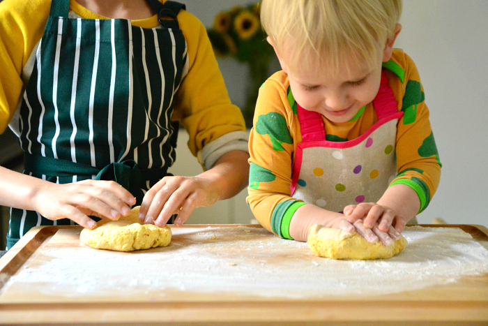 Child made flat bread at How we Montessori toddler cooking at two years