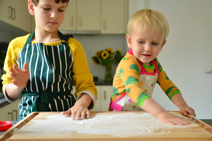 How we Montessori kids baking flat bread  spreading flour on board