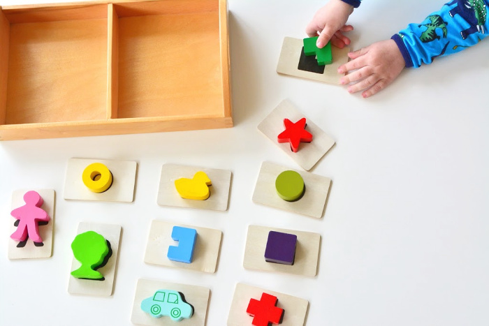 Touch and feel game at How we Montessori two year old