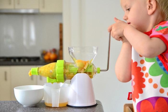 Montessori toddler juicer hand crank Otto two years