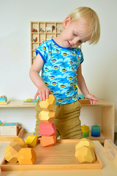 Toddler Tumi ishi at How we Montessori balancing blocks wooden