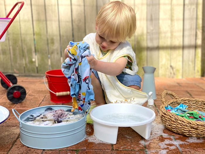 Montessori Toddler Practical life washing clothes with wash tub at How we Montessori
