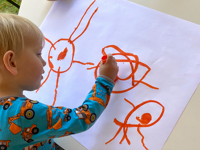 Otto drawing with paint sticks at 2 years 11 months how we montessori
