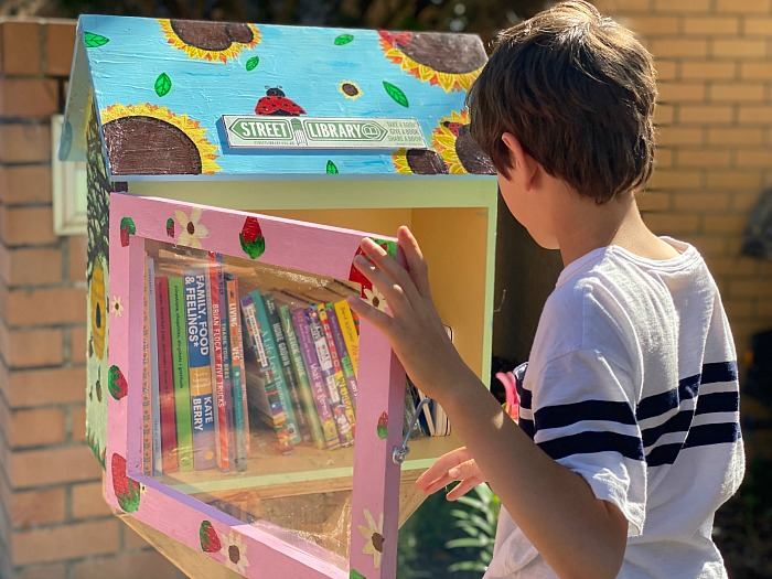 Otis using street library at How we Montessori Sydney Australia chidlren's street library