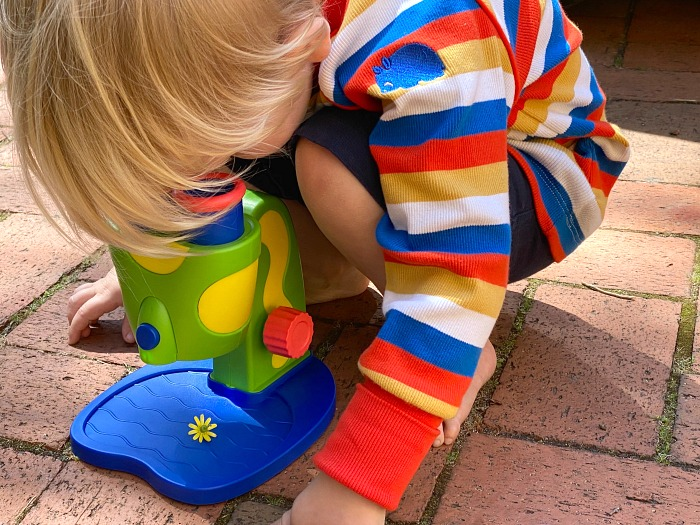 How we Montessori take a microscope outside Otto three year old