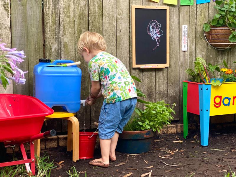 Tap water source at How we Montessori gardening three year old