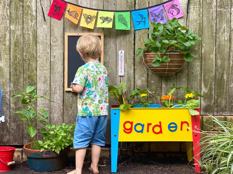 Gardening water source container at How we Montessori three year old gardening activity