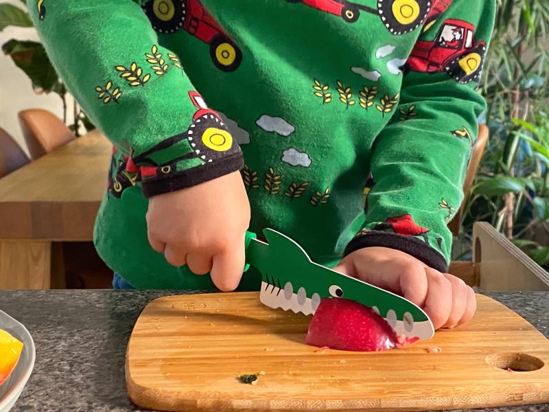 Mini chef knife at How we Montessori Otto three years old cutting apple