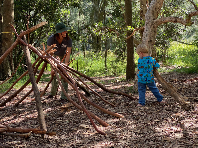 Otto building a shelter  Bush School Centennial Park Sydney 2021 Three years old.