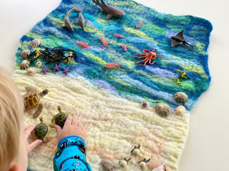 Wet felted playmat at How we Montessori ocean playscape