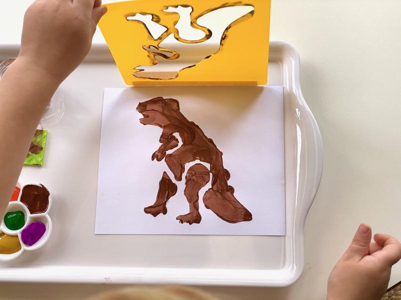 Dinosaur stencil work at How we Montessori