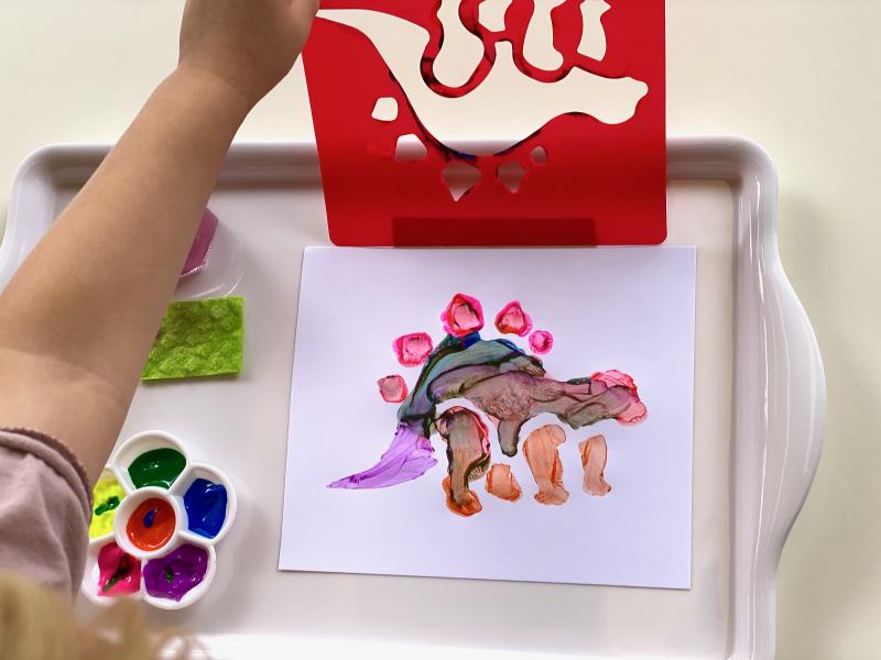 Dinosaur stencil at How we Montessori Otto three years