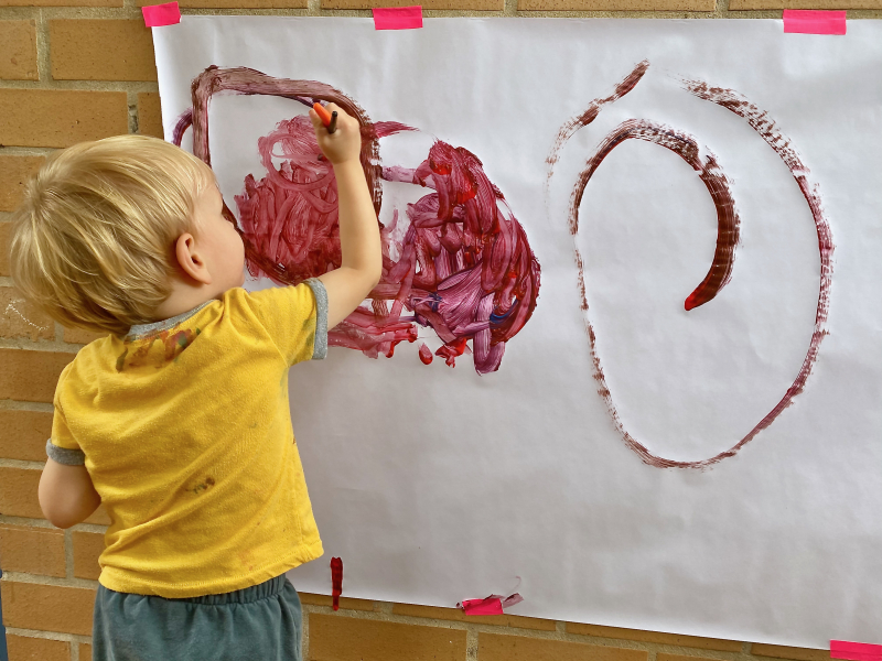 Otto wall painting at How we Montessori three years old Sydney