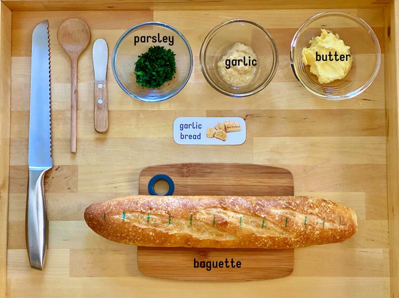 Kids can make garlic bread at How we Montessori at three years