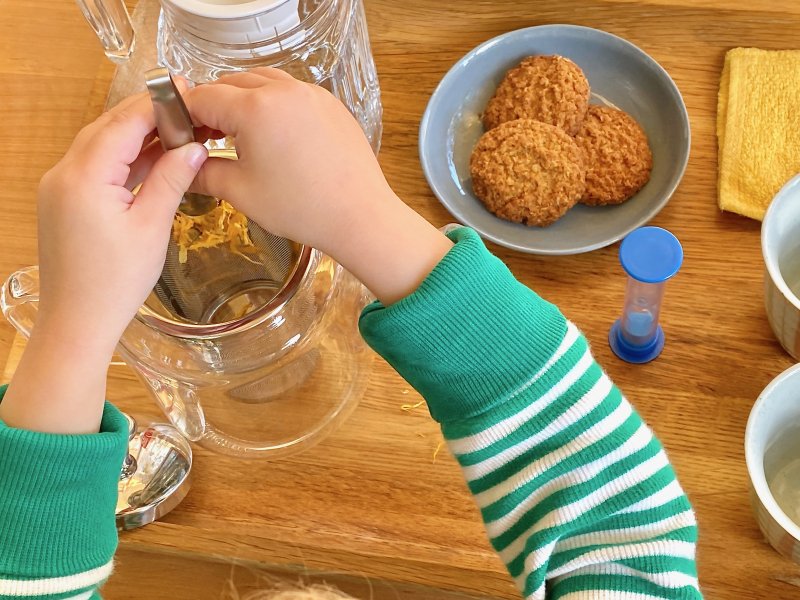 Making tea with an infuser at How we Montessori practical life tray