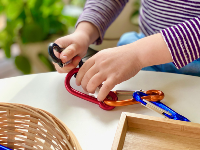 Carabiner play at How we Montessori