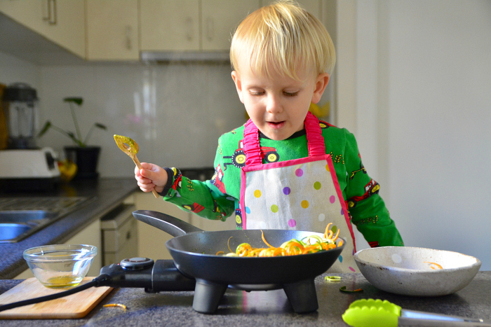 Montessori toddler cooking at How we Montessori cooking sensory experience