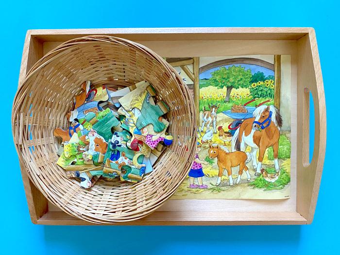 How  we Montessori floor puzzle basket