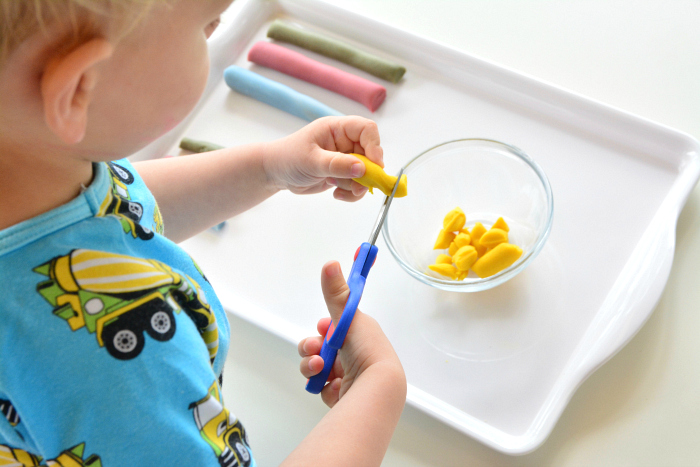 How we Montessori play dough cutting tray for toddler at two years old