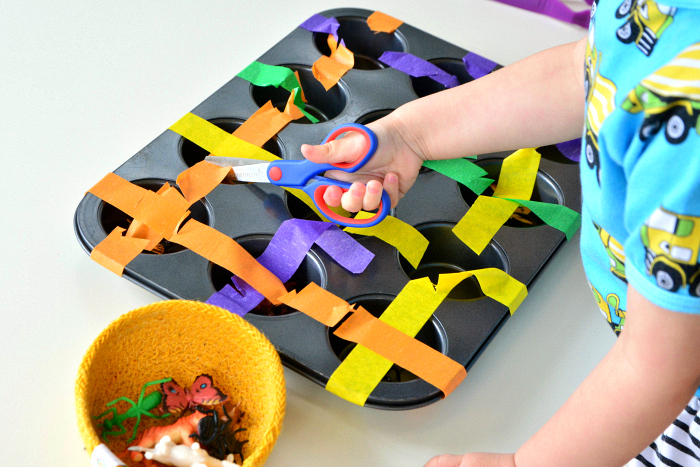How we Montessori toddler muffin cutting tray with scissors at Two years-5
