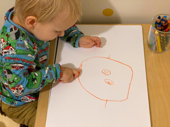 Toddler drawing people at How we Montessori Otto 34 months