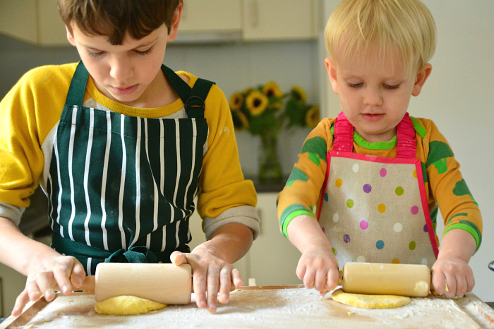 Shaping the dough at How we Montessori flat bread child made recipe