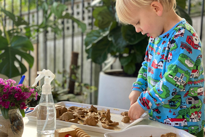 How we Montessori toddler clay tray Otto at Two Years