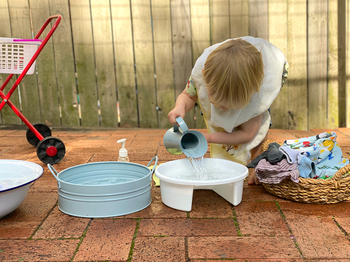 Montessori Toddler Laundry washing outdoors at how we Montessori