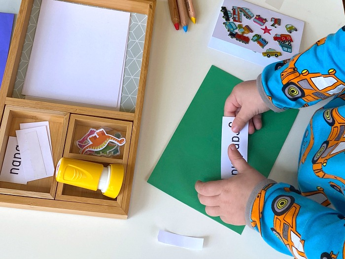 Putting on label prewriters writing tray at How we Montessori