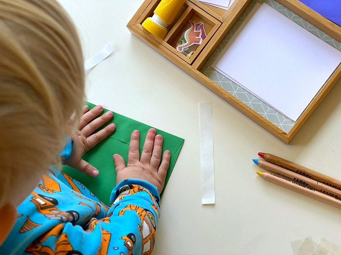 How we Montessori toddler letter writing tray