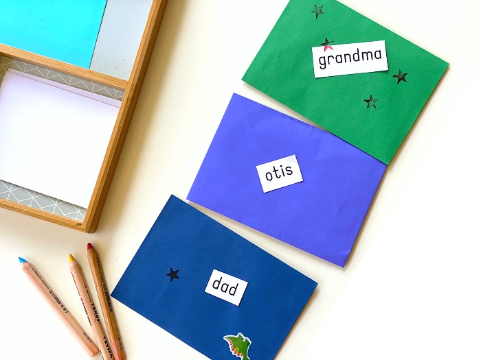 Toddler letter writing tray activity at How we Montessori finished envelopes