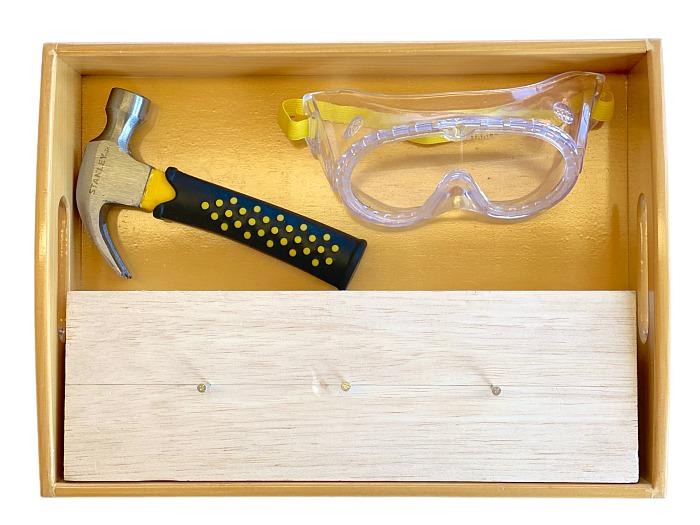 Montessori toddler hammer nails tree stump at How we Montessori