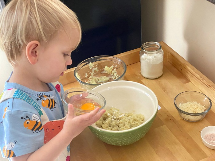 Otto adding egg to gnocchi at How we Montessori