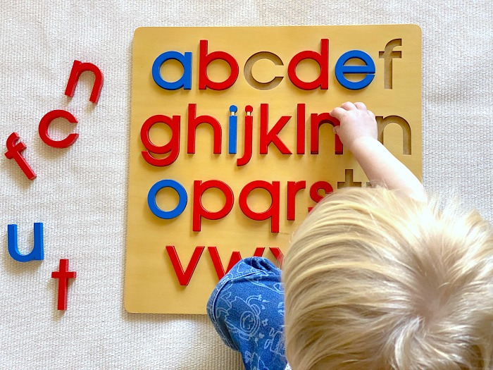 How we Montessori Alphabet Puzzle Otto three years reading letter sounds