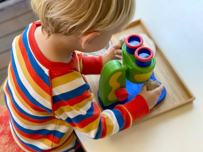 How we Montessori first microsope Otto three year old