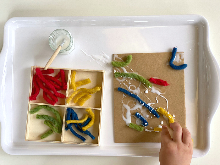 Wool crafts fine motor skills at How we Montessori