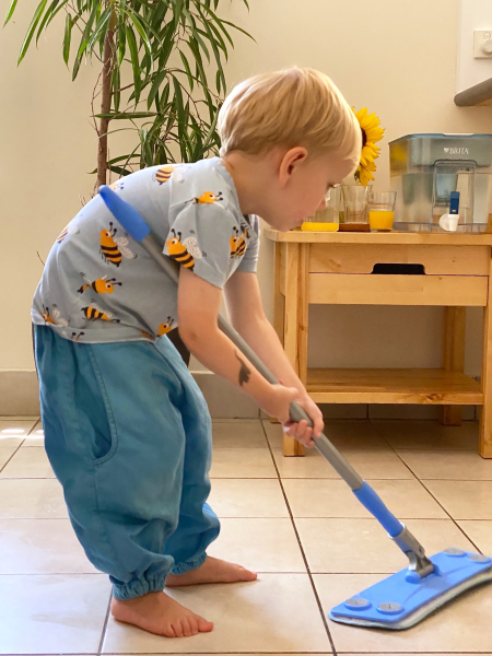 Otto mopping floor at How we Montessori three year old practical life