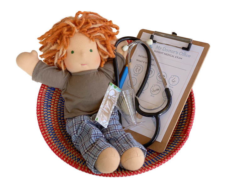 Doctor role play  imaginative play at How we Montessori Doctor Set three year old
