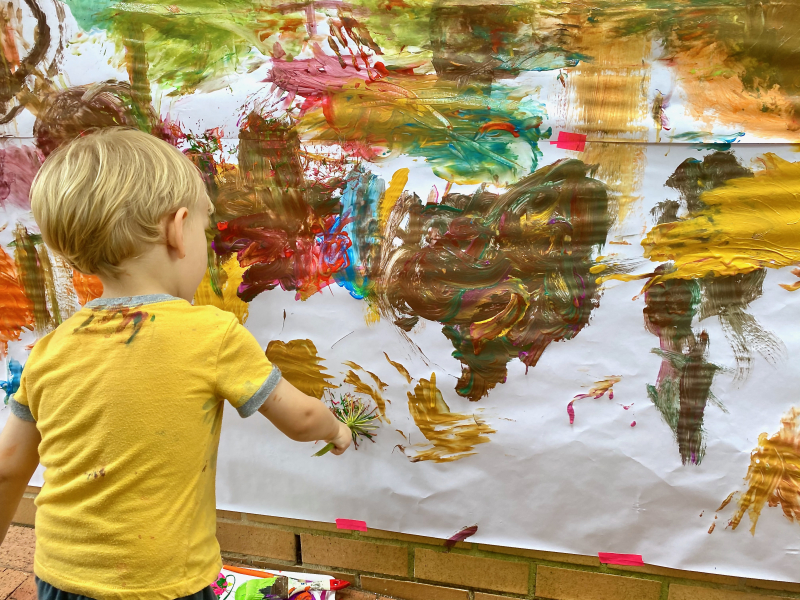 Messy painting wall at How we Montessori Otto three years old