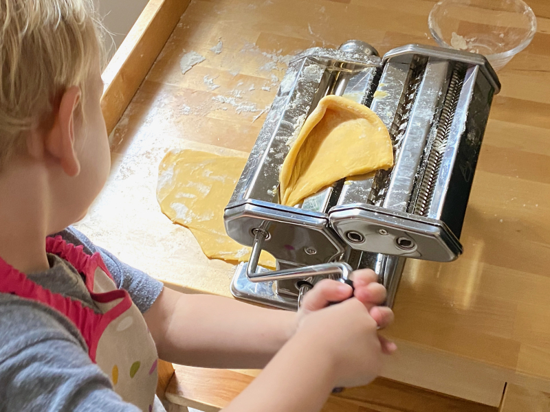 Rolling pasta dough at How we Montessori with kids