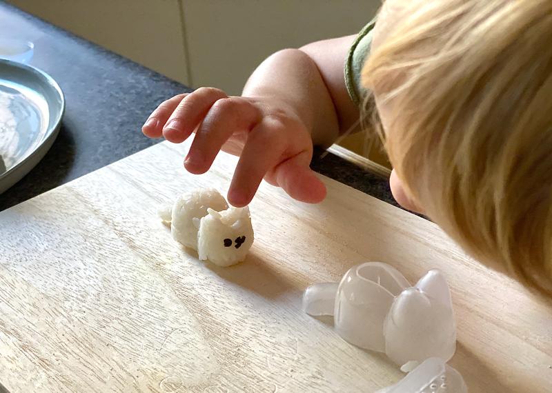 Kids making Japanese rice balls at How we Montessori Otto three years