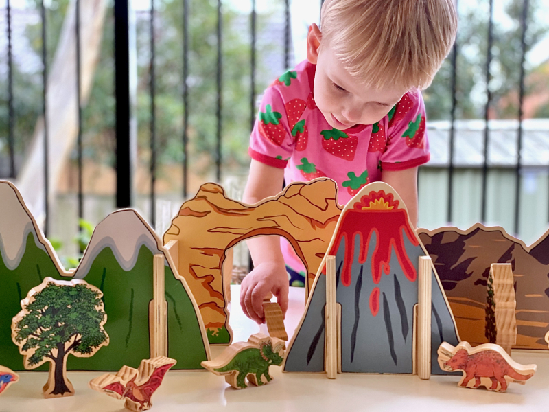 Little architect dinosaurs volcano scene at How we Montessori play Sydney toy library (1)