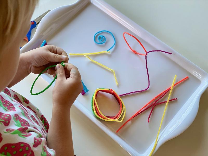 Wikki stix at How we Montessori art activity modeling tray (2)