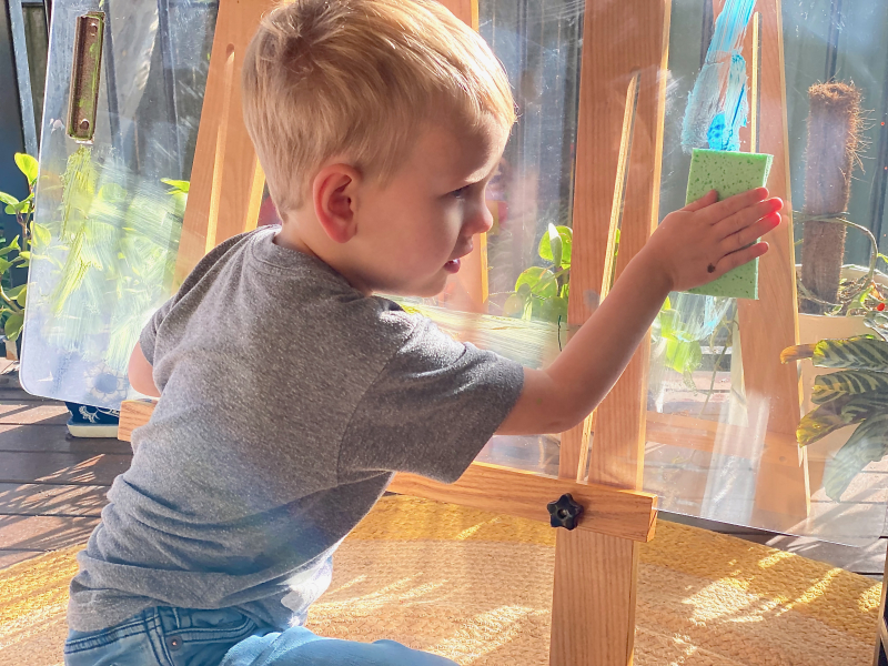 Sponge cleaning up painting easel at How we Montessori