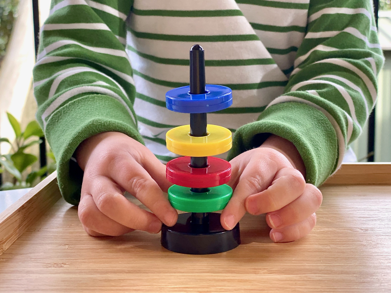 Magnetic ring game at How we Montessori activity tray science