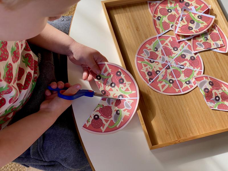 Cutting pizza thirds at How we Montessori cutting scissor practice
