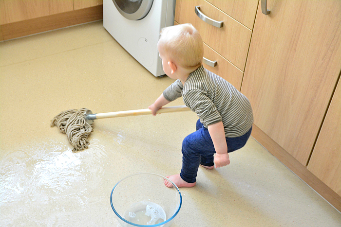 Toddler mopping at how we Montessori